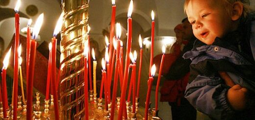A boy looks at the candles at the Peter and Paul church in Moscow on April 7, 2007. The Orthodox Easter and Catholic Easter coincide this year. (UPI Photo/Anatoli Zhdanov)